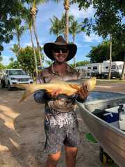 Ollie is having lunch at Karumba Point Sunset Caravan Park. Nice catch